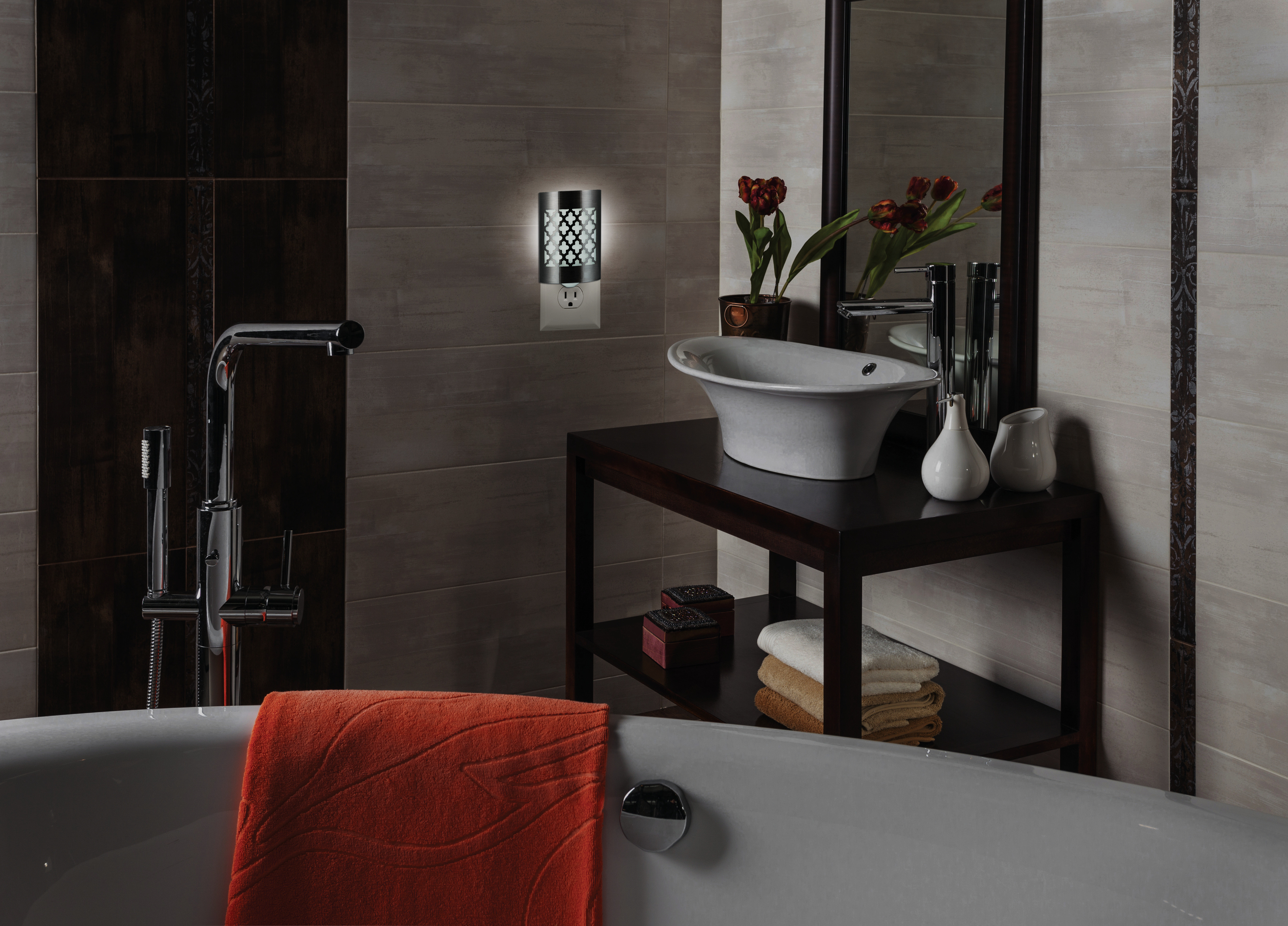 Brush nickel decorative night lights bring high end finishes to small places