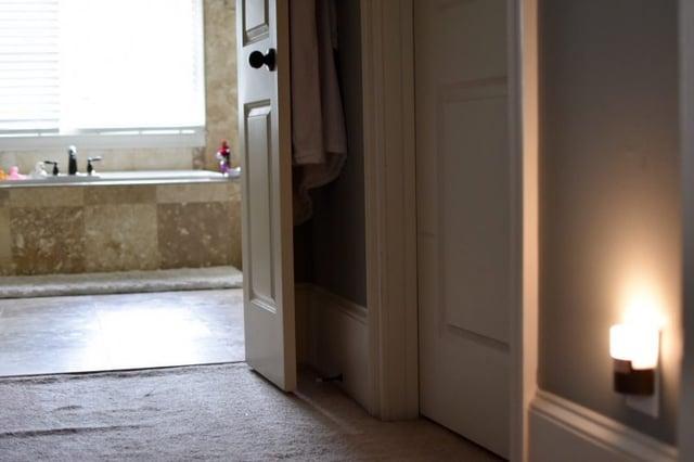 Motion Sensor Night Light illuminating path to the bathroom